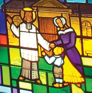 St. John Vianney Blesses an Orphan - Detail of Stained Glass Window at Saint John Vianney Church, Johnstown, PA